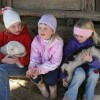 Some young visitors enjoy hanging out with the goat kids at Celebrity Dairy. Photo by Debbie Roos.