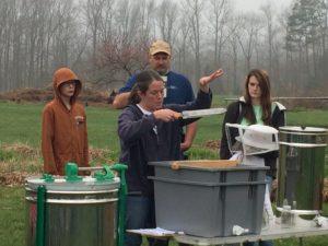 Farmer, Bevin Fink teaching NC Farm School participants how she harvests honey