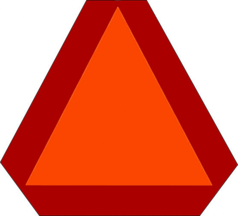 Slow moving vehicle (SMV) sign