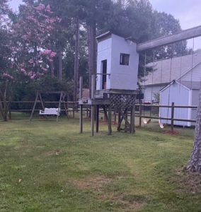 playhouse and swingset in the yard