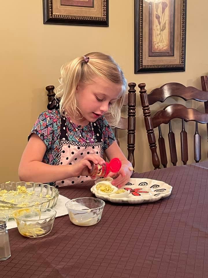 Girl making deviled eggs